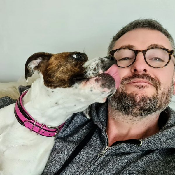 Our Co-Founder, Richard with Biscuit the Boxer/Staffy cross!